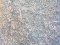 Ohjeita eri materiaaleista valmistettujen kudonnaisten ja neuleiden pesemiseksi